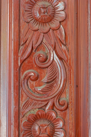 Patterns carved wooden doors, flowers photo