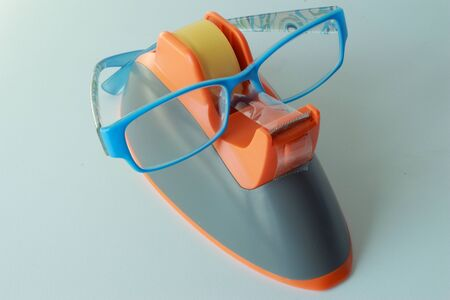 Clear adhesive tape and blue glasses Stock Photo - 16408462