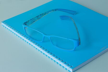 Book, blue glasses  photo