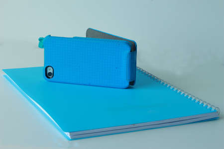 book, mobile phone in blue photo