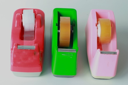 Clear adhesive tape in red, green, pink, photo