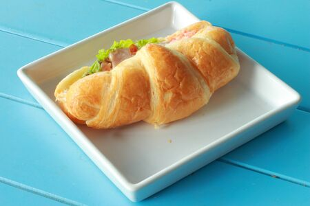 Bread croissants ham cheese white plate  Stock Photo - 16527228