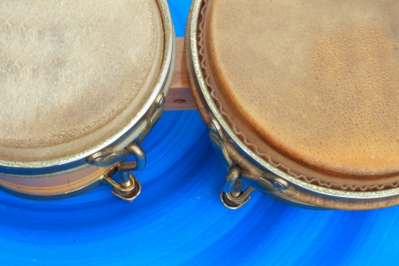 Bongo drums blue background  photo
