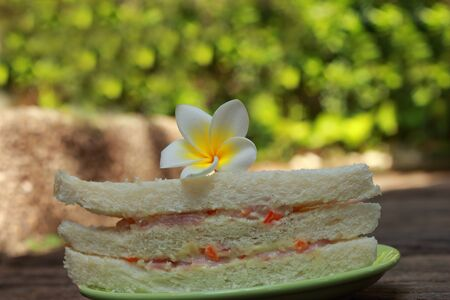 Sandwich with white flowers  photo