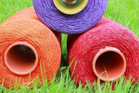 Thread on the green grass  photo
