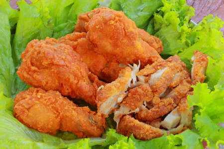 Fried chicken slices on lettuce  photo