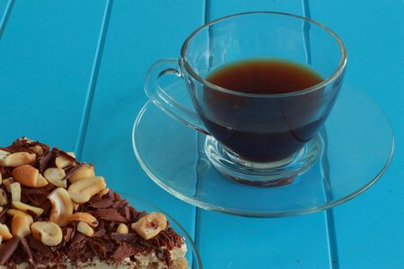 Hot coffee with cake cashew nuts  photo