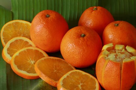 Orange on a banana leaf  Stock Photo - 17478915