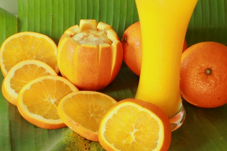Orange juice in a glass on a banana leaf Stock Photo - 17509098