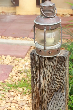 Lighting lamp on a wooden pole  photo