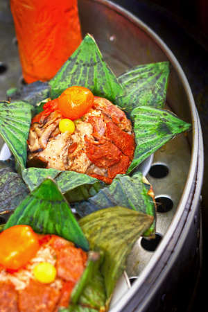 Steamed rice wrapped in lotus leaf. photo