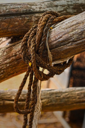 Old rope tied to a piece of old wood  photo