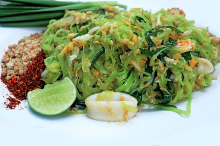 Stir-fried noodles, green lines put the squid and pork. Stock Photo - 24299967