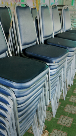 Blue chairs stacked photo