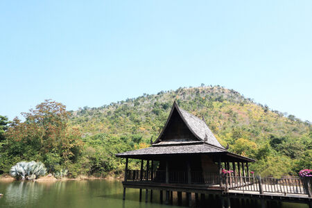 Thai Wooden structure in the river photo