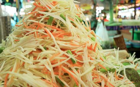 green papaya salad: Papaya salad ingredients on a banana leaf