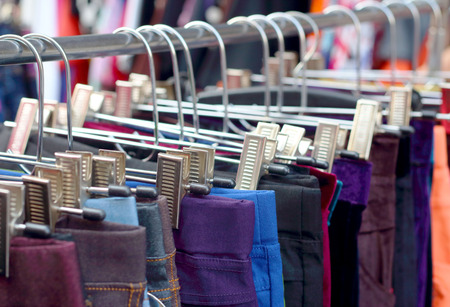 Shop pants hanging on a rack market  Stock Photo