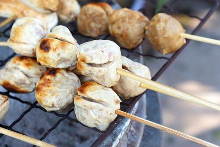 grilled meatballs in the market photo