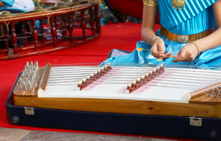 wrest: Children playing dulcimer Thailand