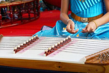 wrest: Children playing dulcimer Thailand