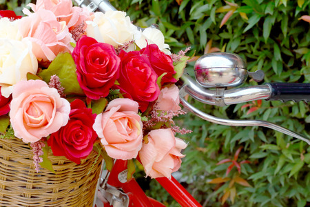 beautiful of rose artificial flowers in vintage bicycle photo