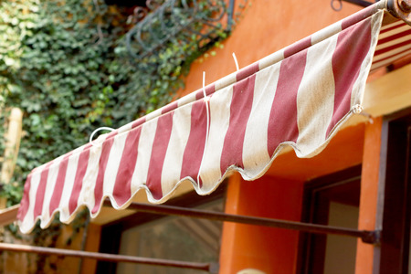 Red and white striped awnings on the building vintage