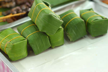 Sausage in banana leaves  photo