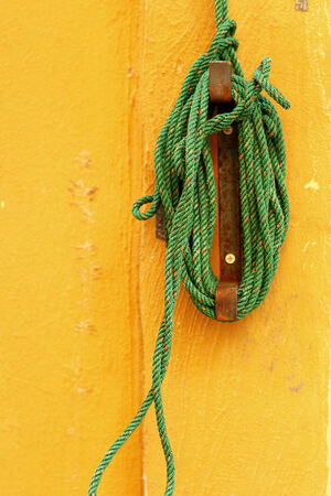 Green nylon rope wall pulling the awning  photo