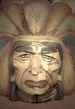 ceremonial clothing: native american indian chief wood carving. Stock Photo