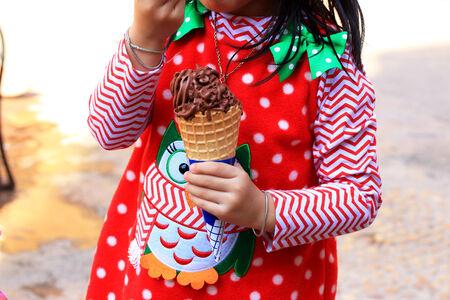 eating ice cream: Girl eating ice cream
