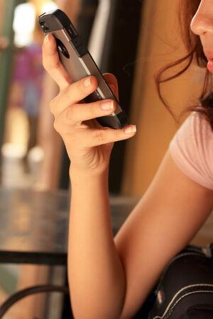 lady on phone: lady Using smart phone Stock Photo