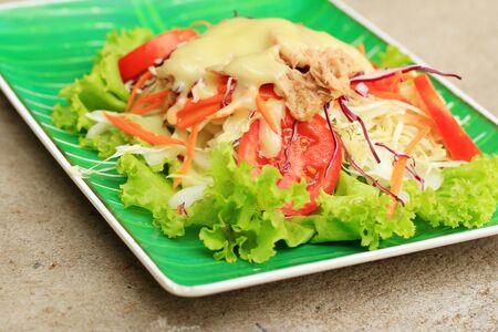 dinner plate: Tuna salad on lettuce and cream sauce