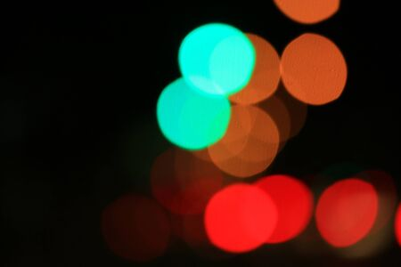 Blurred bokeh of car in city at night