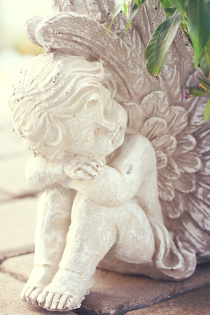Vintage cupid sculpture