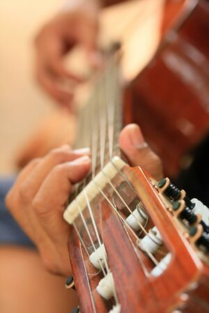man playing guitar: man playing guitar Stock Photo