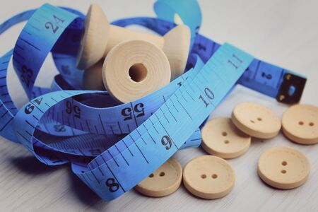 bobbin: Measure tape and bobbin and wood buttons.