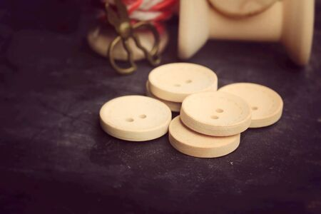 bobbin: Vintage wooden bobbin thread and buttons.