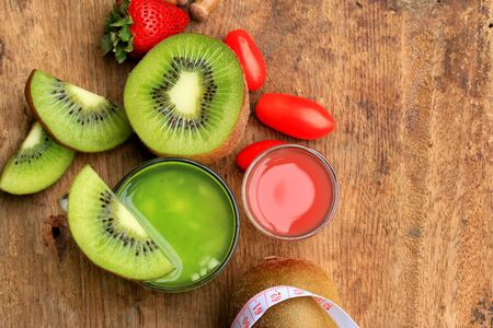 blend: fresh kiwi juice and strawberry on wood vintage Stock Photo