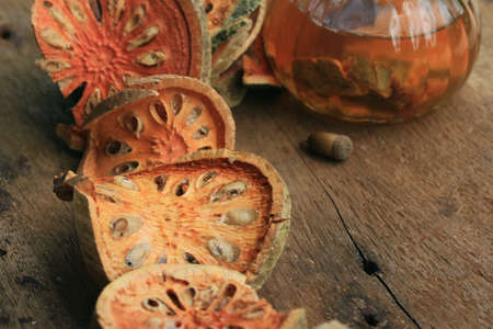 leathery: Slices of dried bael fruit and juice Stock Photo