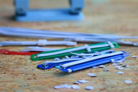 punch press: paper puncher and plastic tongue to the file Stock Photo