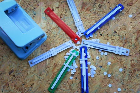 paper puncher: paper puncher and plastic tongue to the file Stock Photo