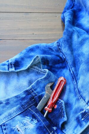 unzipped: Vintage jeans background and tools