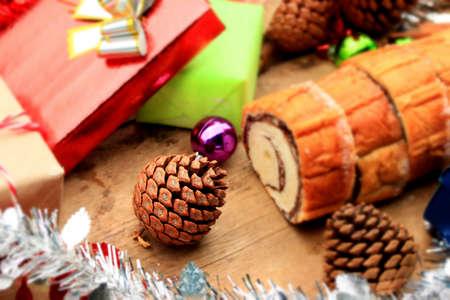 festive pine cones: Chocolate cake yule log Stock Photo
