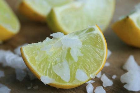 salty: lemon sliced with salt Stock Photo