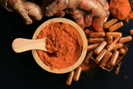 tumeric: fresh turmeric with capsules