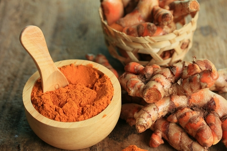 fresh turmeric with powder Stock Photo
