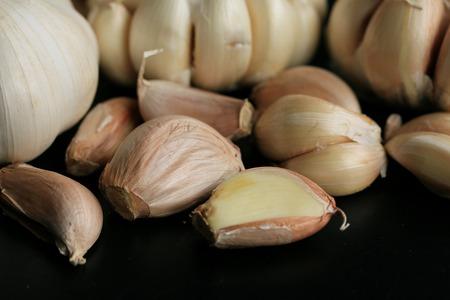 clove plant: heaps with white garlic Stock Photo