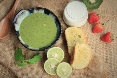 apple sack: spinach soup with breakfast Stock Photo