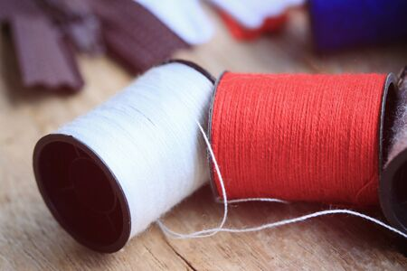 thread spool and zipper Stock Photo