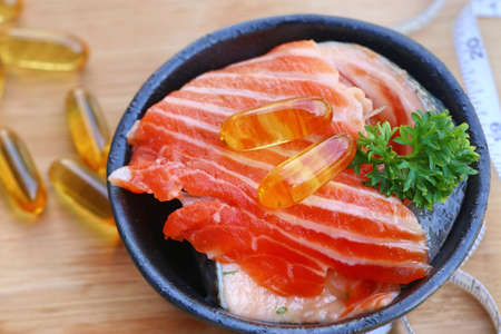 gel capsule: fish oil capsules with fresh Stock Photo